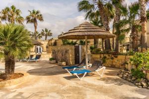 Een patio of ander buitengedeelte van Gozo Village Holidays