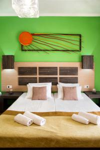 A bed or beds in a room at Acapulco Marinos Apartments- Adults Only