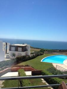 A view of the pool at Terraços da Peralta or nearby