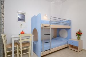 A bunk bed or bunk beds in a room at Victoria Studios & Apartments