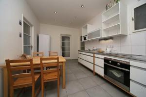 A kitchen or kitchenette at Apartments Vorsilska