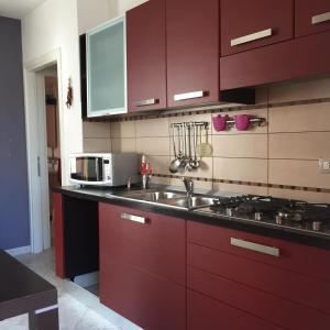 A kitchen or kitchenette at Atene Apartment