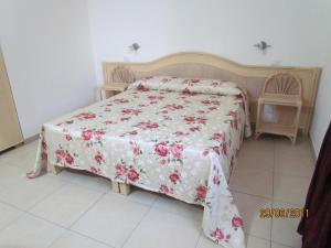 Кровать или кровати в номере Villaggio Hotel Agrumeto