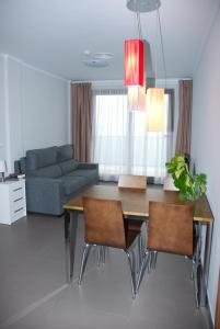 A seating area at Aparthotel El Faro