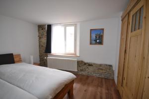 Ein Bett oder Betten in einem Zimmer der Unterkunft Bachperle