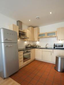 A kitchen or kitchenette at Stay Deansgate Apartments