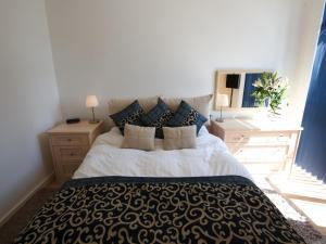 A bed or beds in a room at Stay Deansgate Apartments