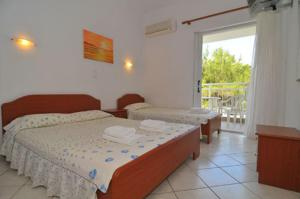 A bed or beds in a room at Villa Iris
