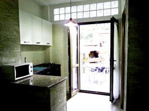 A kitchen or kitchenette at Holiday home Diaz Buggerru