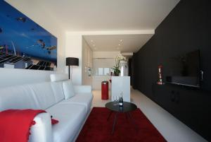 A seating area at Luxe Apartment Filine