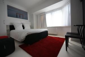 A bed or beds in a room at Luxe Apartment Filine
