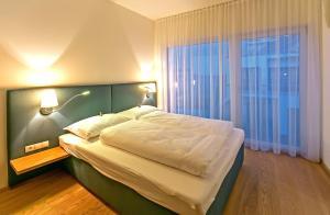 Cama o camas de una habitación en Getreidemarkt 10 Apartments