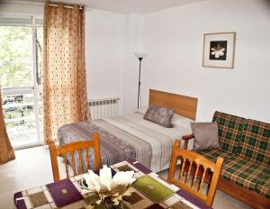 A bed or beds in a room at Village Atocha Apartments
