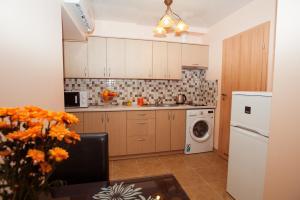 ครัวหรือมุมครัวของ Apartamentai Vyta