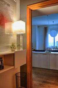 A kitchen or kitchenette at Come A Casa