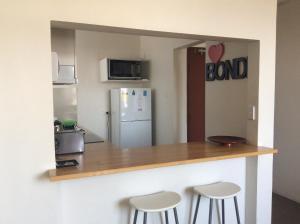 A kitchen or kitchenette at The Chee Bondi