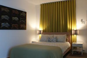 A bed or beds in a room at The Chee Bondi