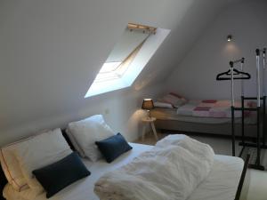 Un ou plusieurs lits dans un hébergement de l'établissement ABC Apartment