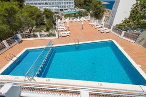 A view of the pool at Apartamentos Es Puet Blanc or nearby