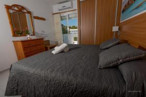 A bed or beds in a room at Apartamentos Es Puet Blanc