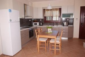 A kitchen or kitchenette at Sofia Luxury Maisonettes