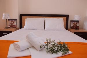 A bed or beds in a room at Sofia Luxury Maisonettes
