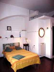Letto o letti in una camera di Residenza Turrena