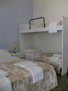 A bunk bed or bunk beds in a room at Residence Marche - Residenza Ecologica
