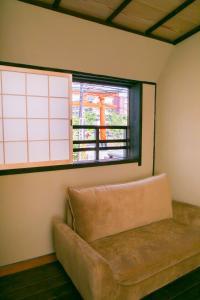 A seating area at Kyomachiya Inari