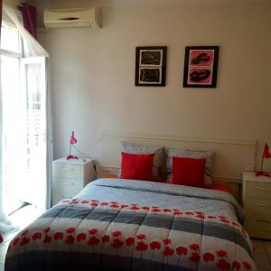 A bed or beds in a room at Festival Residence Apartments