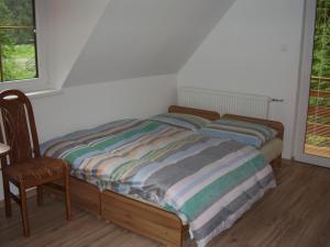 Posteľ alebo postele v izbe v ubytovaní Privat Mikyska