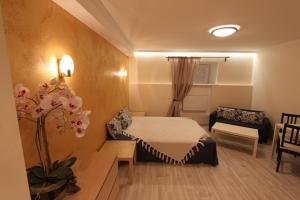 A bed or beds in a room at Tallinn City Center Apartment