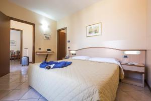 Ein Bett oder Betten in einem Zimmer der Unterkunft Residence XX Settembre