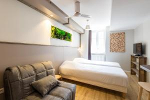 Un ou plusieurs lits dans un hébergement de l'établissement Les Capucins