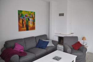Ein Sitzbereich in der Unterkunft Ferienhaus Achterwasseridyll - FeWo 01