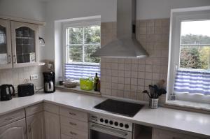 Küche/Küchenzeile in der Unterkunft Ferienhaus Achterwasseridyll - FeWo 01
