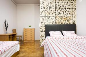 Lova arba lovos apgyvendinimo įstaigoje Berry Apartments