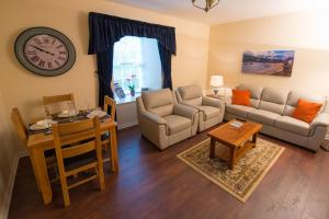 A seating area at The Mill Inn Apartments