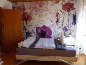 Ein Bett oder Betten in einem Zimmer der Unterkunft Ferienwohnung Tegernheim