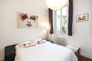 Un ou plusieurs lits dans un hébergement de l'établissement Pick a Flat - Residence Mornay