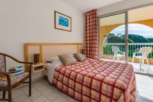 Un ou plusieurs lits dans un hébergement de l'établissement Lagrange Vacances Villa Barbara