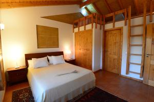 A bed or beds in a room at Casas Buganvilia