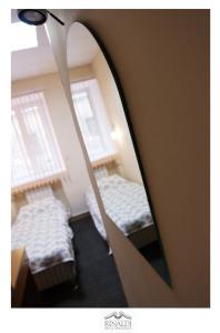 A bed or beds in a room at Rinaldi at Petropavlovskaya