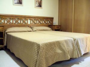 Cama ou camas em um quarto em Bahia de San Antonio Beach