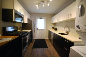 A kitchen or kitchenette at BCA Furnished Apartments