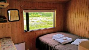 A bed or beds in a room at Thingvellir Lake Cottage