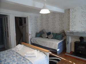 A bed or beds in a room at Erminy House