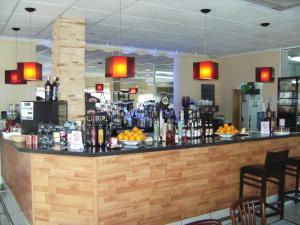Salone o bar di Reception La Rotonda Aparthotel