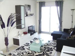 TV o dispositivi per l'intrattenimento presso Reception La Rotonda Aparthotel