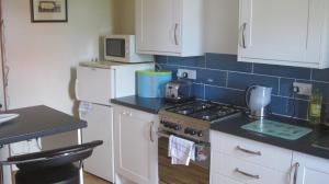 A kitchen or kitchenette at Earsham Park Farm